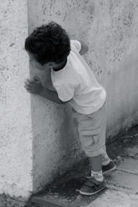 Child playing hide & seek